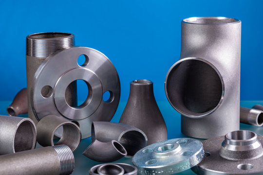 Set of steel welding fittings like tees, elbows, flanges, reducers, sockets, nipples, cups and others.