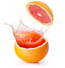 grapefruit juice splashing isolated on white background