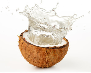 Wall Mural - water splashing from a coco nut isolated on white