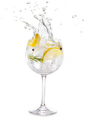 Acrylic Prints Cocktail gin tonic splashing isolated on white background