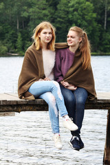 Two young girls having time together in summer season