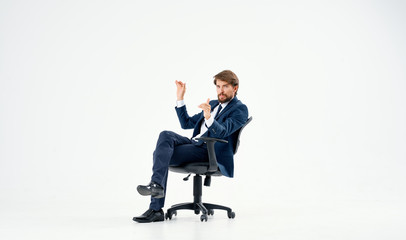 business man sitting on a chair on an isolated background