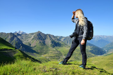 Tourist looking at the mountain landscape in the Pyrenees national park. Occitanie, France.