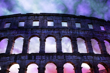 The Roman Amphitheater with stormy sky in Pula, ancient monument in Croatia.