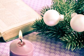 Wall Mural - open bibble with Christmas decorative balls, pine and candle like Christian Catholic Cristmas