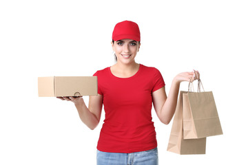 Delivery woman with cardboard box and paper bag on white background