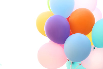Colored rubber balloons on white background