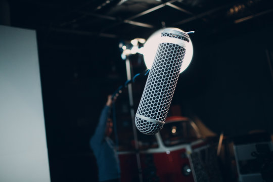 Sound engineer holding a microphone