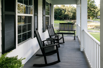 Front Porch of Southern home with Black Rocking Chairs and a Casual Feel Wall mural