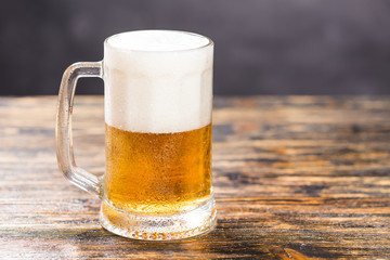 Food and drink concept - Glass beer on wood background with copy space