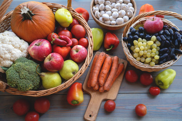 Basket full of mixed of useful vegetables on a wooden background