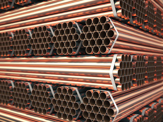 Copper or bronze metal pipes in warehouse. Heavy non-ferrous metallurgical industry.