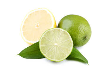 Lemons and limes with green leafs isolated on white background