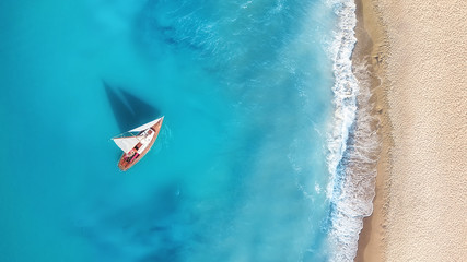 Yacht on the water surface from top view. Turquoise water background from top view. Summer seascape...