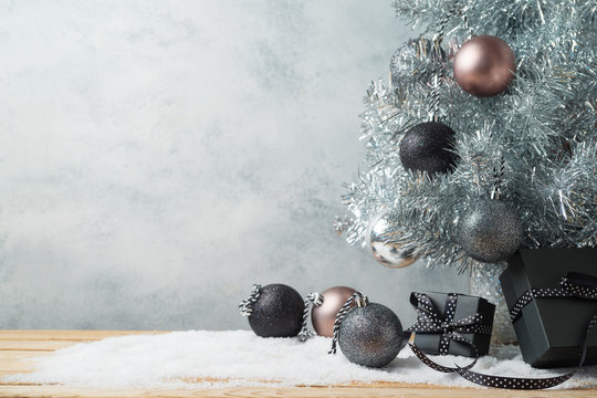 Modern Christmas background with gift boxes, pine tree  and ornament on wooden table