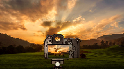 Digital camera with sunrise over Paddy field 1
