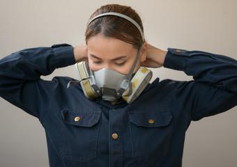 women protection cartridge respirator gas mask - close up. Wall mural