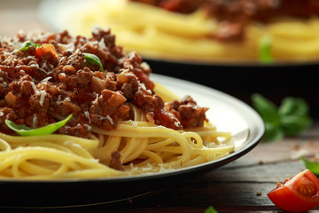 Italian pasta bolognese with beef, basil and parmesan cheese