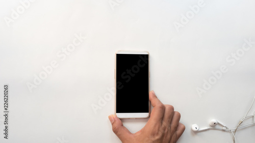 Wall mural smartphone and hand hold business concept white background