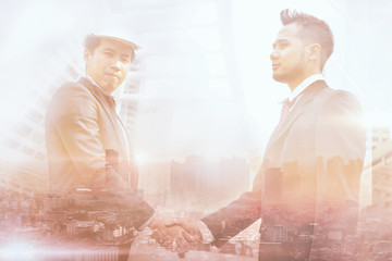Double exposure of two businessmen checking hand