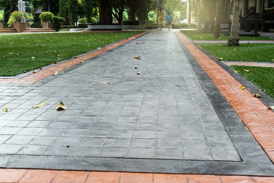 Printed concrete texture and green artificial grass.