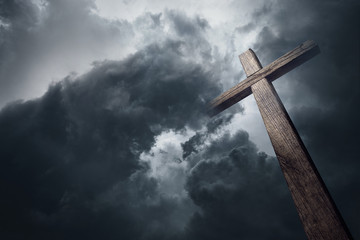 Dramatic cloudscape and wooden cross