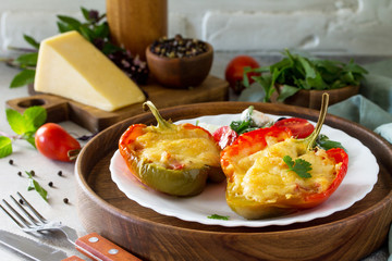 Stuffed peppers with turkey meat and cheese on a light stone background. Healthy food. Copy space.