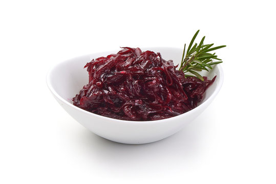 Bowl full with grated beets with herbs. Isolated on a white background