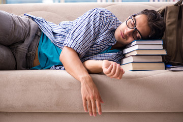 Tired student lying on the sofa