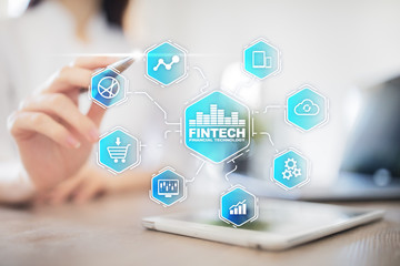 Fintech. Financial technology text on virtual screen. Business, internet and technology concept.