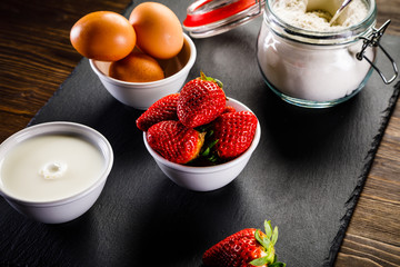 Ingredients for pancakes on black stone plate