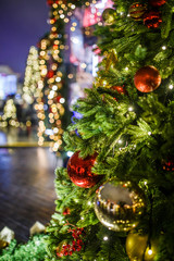 Photo of New Year decorated fir trees on blurred background