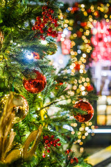 Picture of New Year decorated branches of fir trees on blurred background