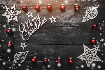 Christmas decoration background over black wooden background, above view with copy space for text