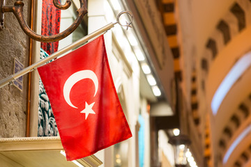 Interior of the Grand Bazaar with Turkish flag in Istanbul, Turkey