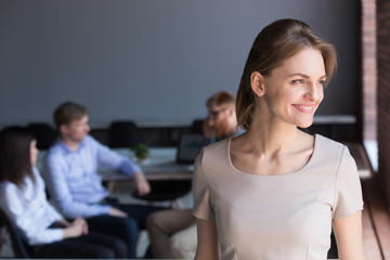 Smiling female leader looking away dreaming of future achievements, businesswoman satisfied with successful career thinking of new goals motivated by good work results, business vision concept
