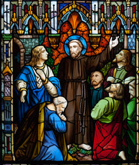 Saint Francis preaching stain glass