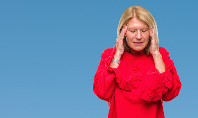 Middle age blonde woman over isolated background with hand on head for pain in head because stress. Suffering migraine.