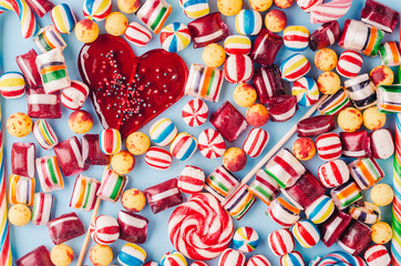 Candies and lollipops on blue background