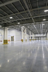 The process of construction and launch of a large logistics center, its internal filling and finishing, the process of formation of the external territory and arrangement of warehouse and office space