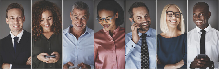 Diverse group of smiling businesspeople using cellphones Wall mural