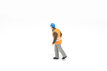 Miniature people worker safety construction concept on white background with a space for text