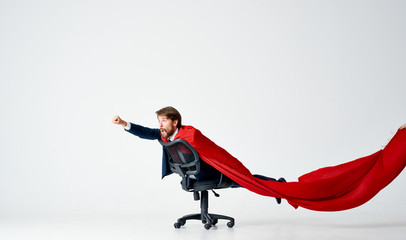 a man in a red sheet is lying on a chair