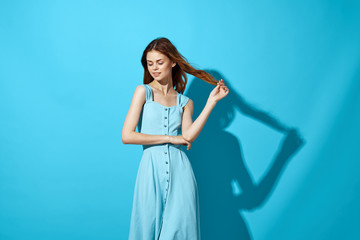 beautiful woman in blue dress on blue background