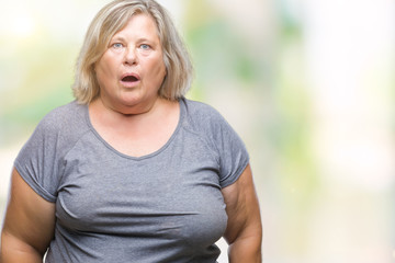 Senior plus size caucasian woman over isolated background afraid and shocked with surprise expression, fear and excited face.