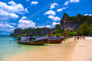 Long tail boats and rocks on Railay beach west, Ao Nang, Krabi,