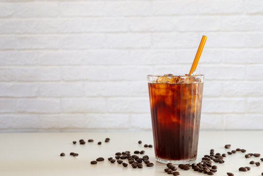 a glass of homemade cold cold brew coffee on white table