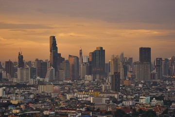 scenic of golden skyline with cityscape on sunset time