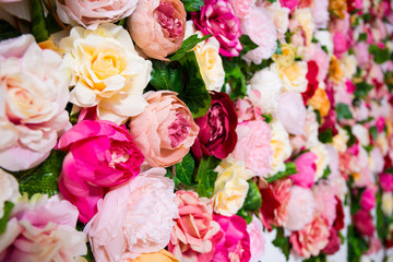 wedding decoration - close up of colorful artificial flowers wall