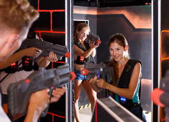 Ordinary Laser tag players playing in teams
